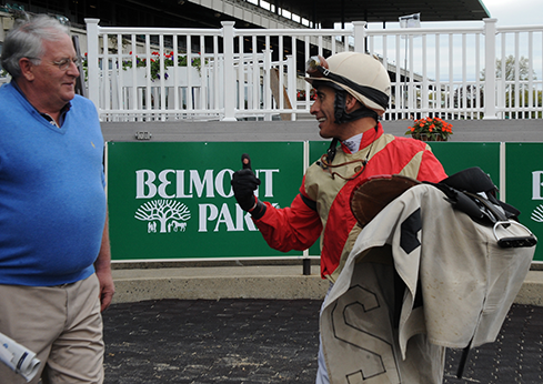 Trainer Jimmy Jerkens and Hall of Fame jockey John Velazquez celebrate Juba's Belmont Park win.