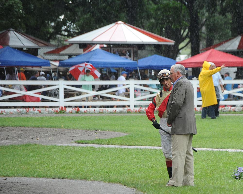 Rainy day strategy session between Jimmy Jerkens and John Velazquez.