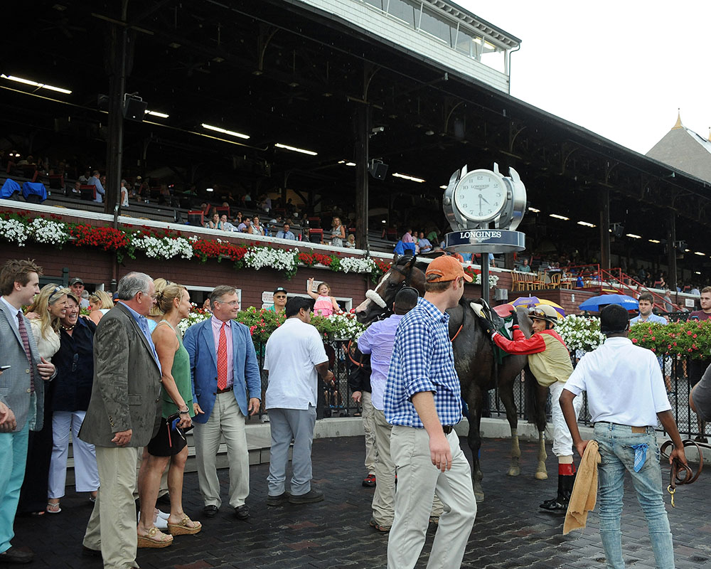 Celebrations abound as John Velazquez takes the tack off of Adulator following their thrilling victory.