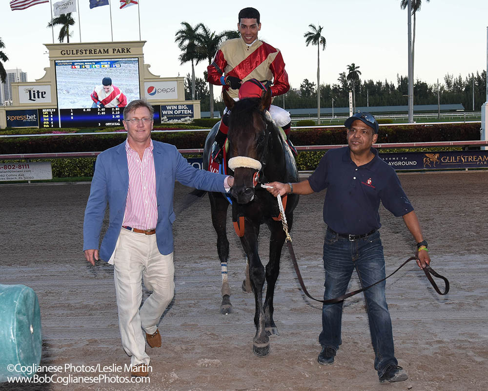Don Little, Jr. accompanies Unified and Jose Ortiz in to the winner's circle after the G3 Gulfstream Park Sprint.