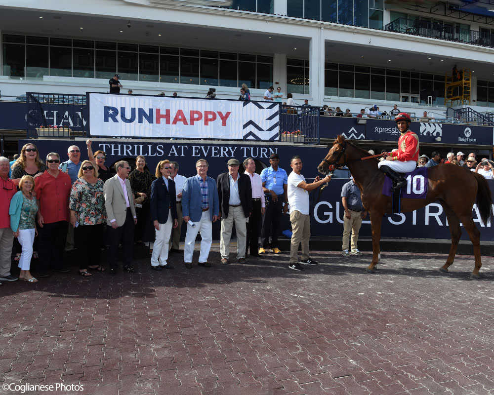 Life On Top breaks his maiden at Gulfstream Park. Thoroughbred racing partnership in the winner's circle.