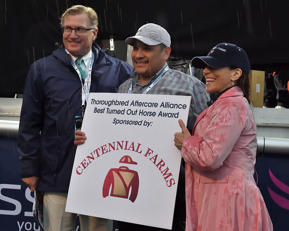 Centennial Farms' Don Little, Jr. presents the Best Turned Out Award for the 2019 Pegasus World Cup at Gulfsream Park with the Thoroughbred Aftercare Alliance.